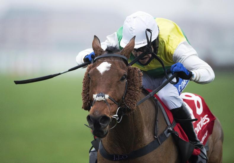 SIMON ROWLANDS:  Slick jumping Cloth Cap right for Aintree