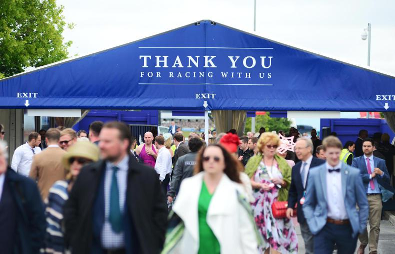 IRISH DERBY: Racegoers grin and bear it