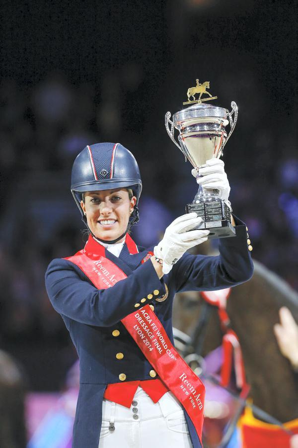 Dujardin sweeps to victory in Lyon